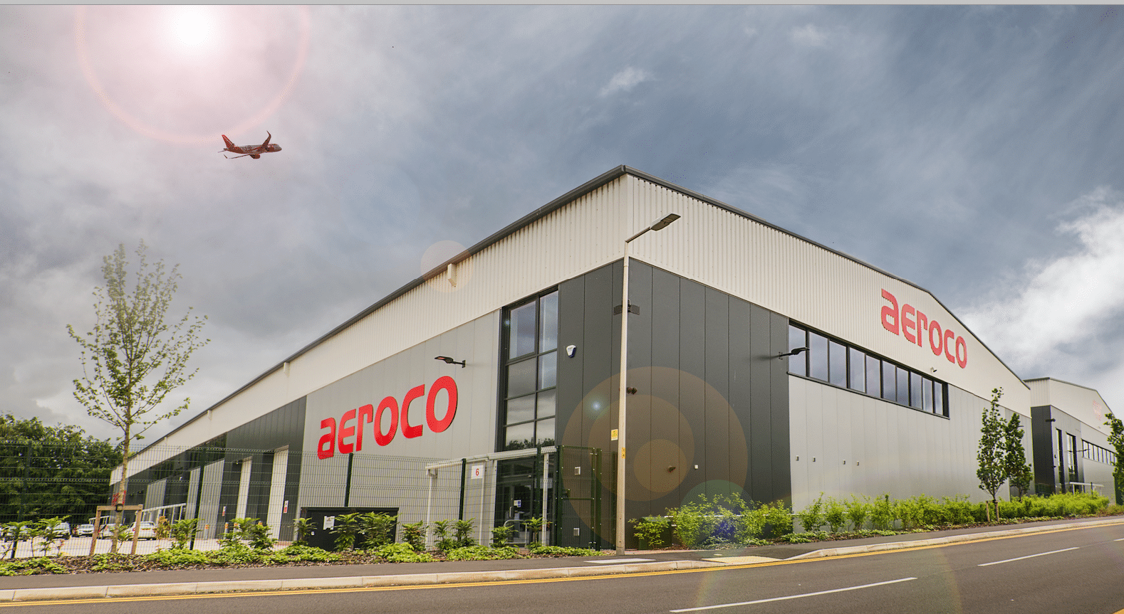 Plane flying over Aeroco HQ